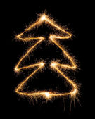 Christmas tree made by sparkler on a black — Stock Photo