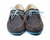 Black men's leather loafers with blue soles and laces on a white — Stock Photo
