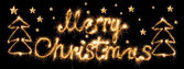 Merry christmas made of sparkles on black — Stock Photo