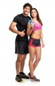 Athletic man and woman with bottle of water on the white — Stock Photo