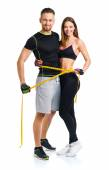 Happy athletic couple - man and woman with measuring tape on the — Stock Photo