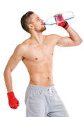 Sport attractive man wearing boxing bandages with bottle of wate — Foto de Stock