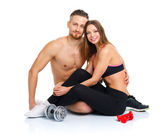 Sport couple - man and woman after fitness exercise sitting with — Foto de Stock