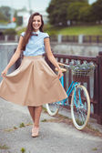 Young beautiful, elegantly dressed woman with bicycle — Foto Stock
