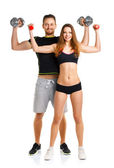 Sport couple - man and woman with dumbbells on the white — Foto de Stock