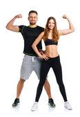 Спортивная(ый) мужчина и женщина после Фитнес упражнения на белом — Стоковое фото