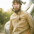 Young pilot posing near the helicopter — Stock Photo #75074777