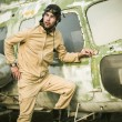 Young pilot posing near the helicopter — Stock Photo #75074785