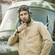 Young pilot posing near the helicopter — Stock Photo #75074791