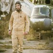 Young pilot posing near the helicopter — Stock Photo #75074803
