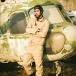 Young pilot posing near the helicopter — Stock Photo #75074815