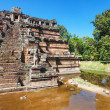 Ancient buddhist khmer temple in Angkor Wat complex — Stock Photo #53331543