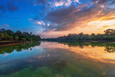 River near ancient buddhist khmer temple in Angkor Wat complex — Stock Photo