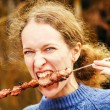 Woman eating kebab — Stock Photo #57095357