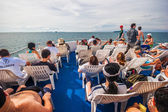 Tourists on the upper deck of a ship — Stock Photo