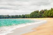 Tropical beach under gloomy sky — Stock Photo