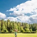 Litlle boy runs with kite — Stock Photo #73884779