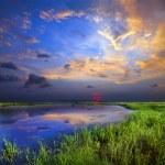 Bright sunset over lake — Stock Photo #66385237