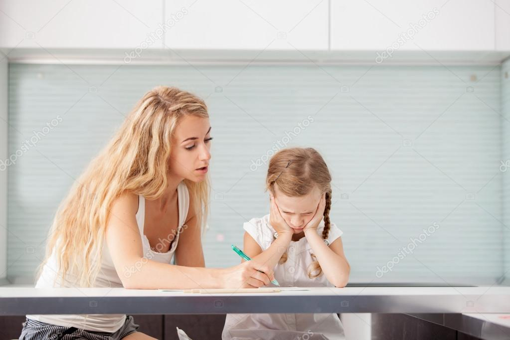 Parent helps the child to do homework — Stock Photo © TatyanaGl ...
