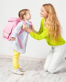 Mother helps her daughter get ready for school — Стоковое фото