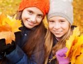 Girls at autumn — Stock Photo