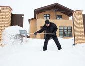 Man cleans snow shoveling  — Stock Photo