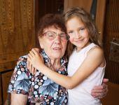 Elderly woman with great-grandchild — Stock Photo