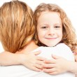 Child embracing mother — Stock Photo #59595391
