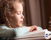 Girl reading book — Stock Photo