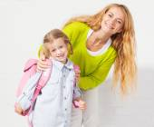 Mother helps her daughter get ready for school — Foto de Stock