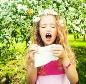 Sneezing girl — Stock Photo
