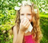 Sneezing girl — Stock Photo