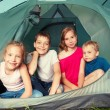 Children in a tent — Stock Photo #64305491