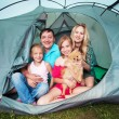 Family in a tent — Stock Photo #64305507