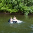 Children floating on the river — Stock Photo #69588119
