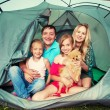 Family in a tent — Stock Photo #69588147