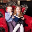 Children reading book at home — Stock Photo #76737787