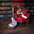 Children reading book at home — Stock Photo #76737799
