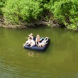 Children floating on the river — Stock Photo #76737813