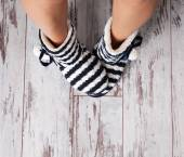 Warm slippers on the background floor — Stock Photo