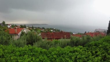 Lightning and thunderstorm above sea bay in daylight, panoramic view. — Stock video