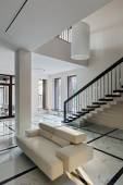 Luxury hall interior with staircase — Stock Photo