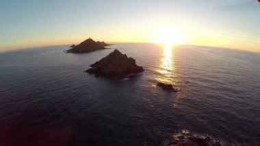 Flight over the sea and islands at sunset, Ajaccio area, Corsica, France. Aerial panoramic view. — Stock Video