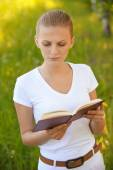 Young beautiful woman holding book — Stock Photo
