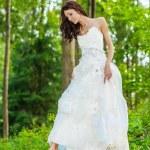 Beautiful bride in white wedding dress — Stock Photo #52894745