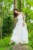 Beautiful bride in white wedding dress — Stock Photo