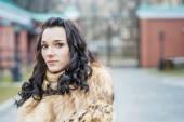 Girl in fur coat — Stock Photo
