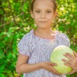 Little girl holding cabbage — Stock Photo #52934155