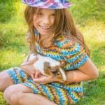 Little girl petting guinea pig — Stock Photo #52938633