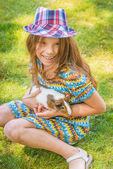 Little girl petting guinea pig — Stock Photo